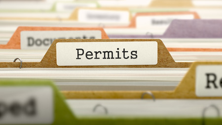 permits: Permits Concept on Folder Register in Multicolor Card Index. Closeup View. Selective Focus. Stock Photo