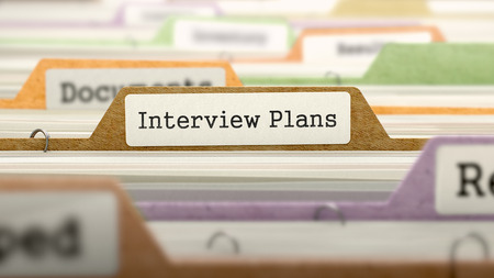 interrogatory: Interview Plans - Folder Register Name in Directory. Colored, Blurred Image. Closeup View. Stock Photo