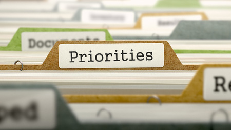 Priorities Concept on File Label in Multicolor Card Index. Closeup View. Selective Focus.