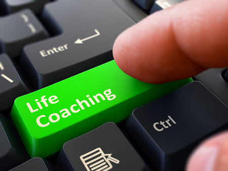 life coaching: Life Coaching Concept. Person Click on Green Keyboard Button with Life Coaching. Selective Focus. Closeup View. Stock Photo