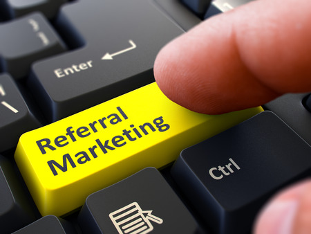 referral marketing: Referral Marketing Concept. Person Click on Yellow Keyboard Button. Selective Focus. Closeup View. Stock Photo