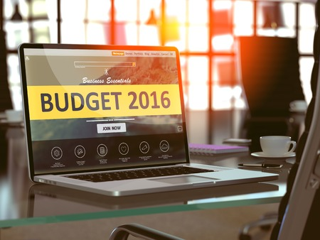 marginal: Modern Workplace with Laptop showing Landing Page with Budget 2016 Concept. Toned Image with Selective Focus.