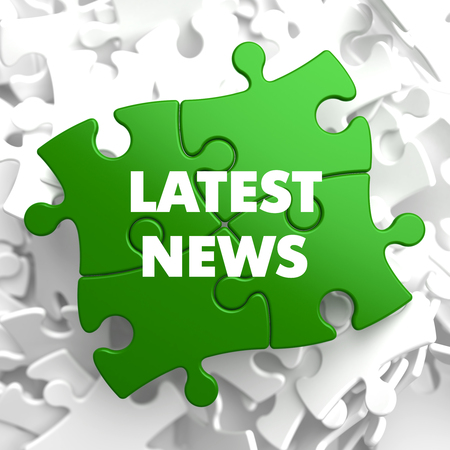 urgent announcement: Latest News on Green Puzzle on White Background. Stock Photo