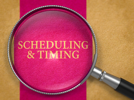 scheduling: Scheduling and Timing Concept through Magnifier on Old Paper with Lilac Vertical Line Background. Stock Photo