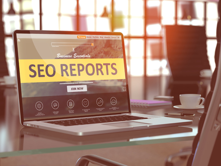 seo services: SEO - Search Engine Optimization - Reports Concept. Closeup Landing Page on Laptop Screen  on background of Comfortable Working Place in Modern Office. Blurred, Toned Image.