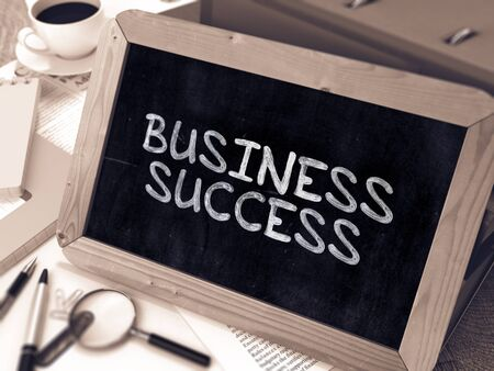 attainment: Business Success Concept Hand Drawn on Chalkboard on Working Table Background. Blurred Background. Toned Image.