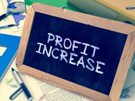 dividend: Hand Drawn Profit Increase Concept  on Chalkboard. Blurred Background. Toned Image. Stock Photo