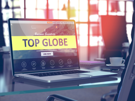 middleware: Top Globe Concept. Closeup Landing Page on Laptop Screen  on background of Comfortable Working Place in Modern Office. Blurred, Toned Image.