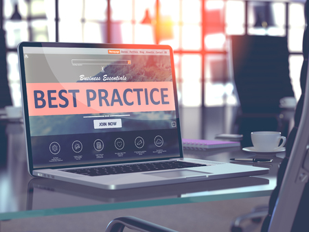 Best Practice Concept Closeup on Laptop Screen in Modern Office Workplace. Toned Image with Selective Focus.