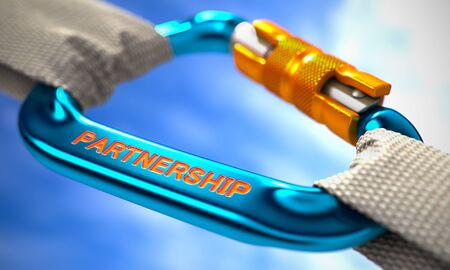 carabiner: Strong Connection between Blue Carabiner and Two White Ropes Symbolizing the Partnership. Selective Focus. Stock Photo