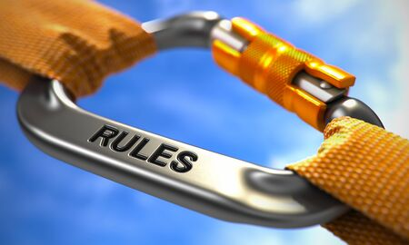 injunction: Rules on Chrome Carabine with Orange Ropes. Focus on the Carabine. 3d Illustration. Stock Photo
