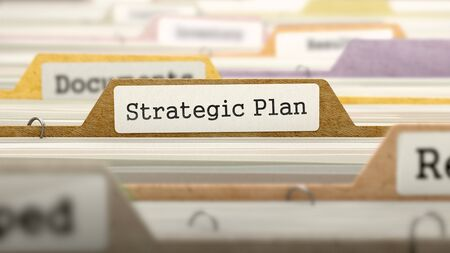 strategic plan: File Folder Labeled as Strategic Plan in Multicolor Archive. Closeup View. Blurred Image.