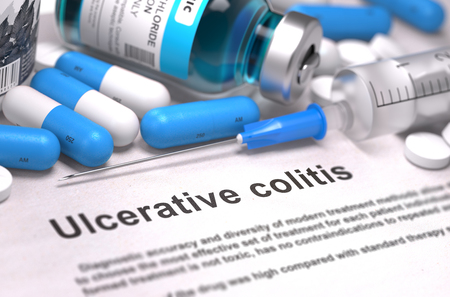 colitis: Diagnosis - Ulcerative Colitis. Medical Report with Composition of Medicaments - Blue Pills, Injections and Syringe. Blurred Background with Selective Focus. Stock Photo