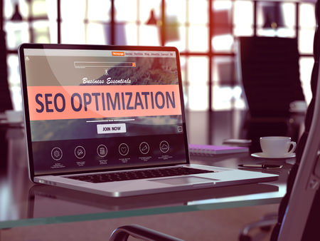 keywords link: SEO - Search Engine Optimization - Optimization Concept. Closeup Landing Page on Laptop Screen  on background of Comfortable Working Place in Modern Office. Blurred, Toned Image. Stock Photo