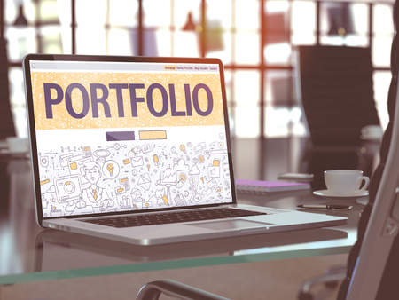 implemented: Portfolio Concept - Closeup on Landing Page of Laptop Screen in Modern Office Workplace. Toned Image with Selective Focus. Stock Photo