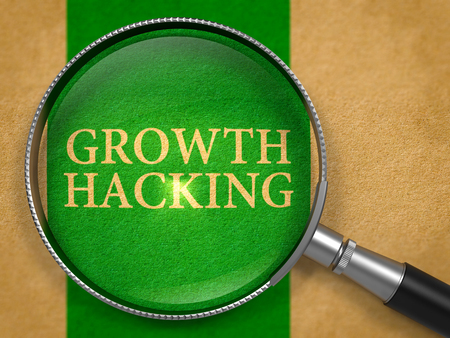 Growth Hacking through Loupe on Old Paper with Green Vertical Line Background.