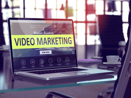 Video Marketing Concept. Closeup Landing Page on Laptop Screen  on background of Comfortable Working Place in Modern Office. Blurred, Toned Image.