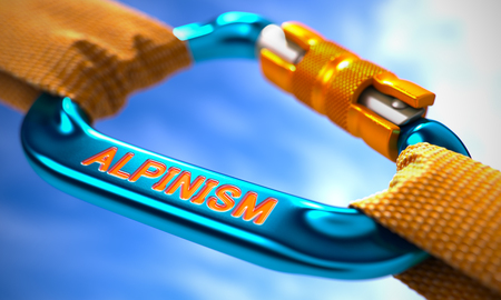 alpinism: Strong Connection between Blue Carabiner and Two Orange Ropes Symbolizing the Alpinism. Selective Focus. Stock Photo