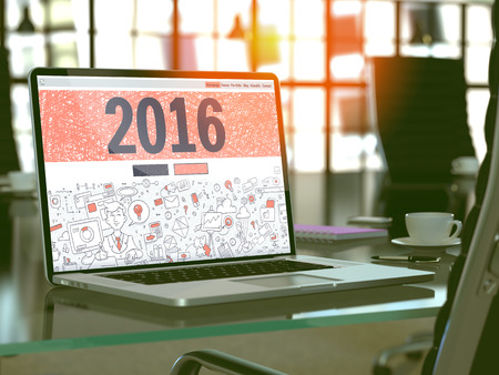 christmas budget: 2016 Concept. Closeup Landing Page on Laptop Screen in Doodle Design Style. On background of Comfortable Working Place in Modern Office. Blurred, Toned Image. Stock Photo