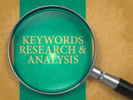 keywords link: Keywords Research and Analysis through Loupe on Old Paper with Blue Vertical Line Background.