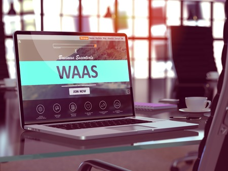 web portal: WAAS - Workspace as a Service - Concept. Closeup Landing Page on Laptop Screen  on background of Comfortable Working Place in Modern Office. Blurred, Toned Image. Stock Photo