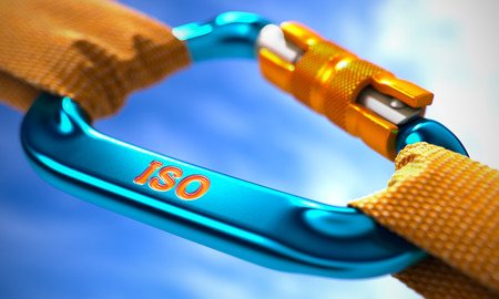 standardization: ISO - International Organization Standardization - on Blue Carabine with a Orange Ropes. Selective Focus.