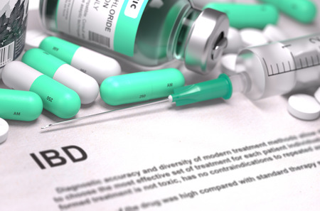 bowel: Diagnosis - IBD - Inflammatory Bowel Disease. Medical Concept with Light Green Pills, Injections and Syringe. Selective Focus. Blurred Background. 3d Render. Stock Photo