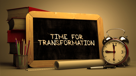 converting: Time for Transformation - Chalkboard with Hand Drawn Text, Stack of Books, Alarm Clock and Rolls of Paper on Blurred Background. Toned Image. 3d Render. Stock Photo
