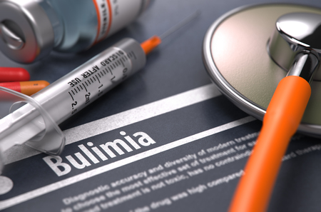bulimia: Bulimia - Printed Diagnosis with Blurred Text on Grey Background and Medical Composition - Stethoscope, Pills and Syringe. Medical Concept. 3d Render.