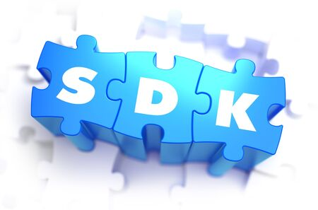 dissemination: SDK - Software Development Kit - Text on Blue Puzzles on White Background. 3D Render. Stock Photo