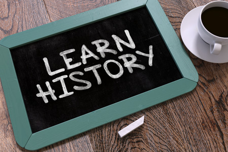 history background: Learn History Concept Hand Drawn on Blue Chalkboard on Wooden Table. Business Background. Top View. 3d Render.