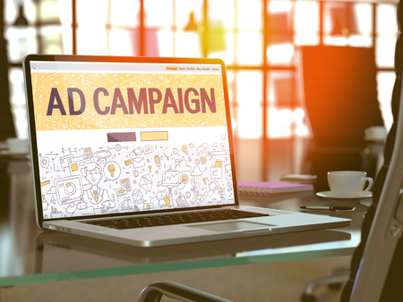 Ad Campaign Concept. Closeup Landing Page on Laptop Screen in Doodle Design Style. On Background of Comfortable Working Place in Modern Office. Blurred, Toned Image. 3d Render. Stock Photo