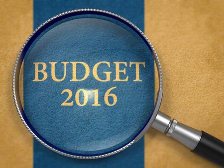 marginal returns: Budget 2016 Concept through Magnifier on Old Paper with Dark Blue Vertical Line Background. 3d Render. Stock Photo