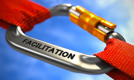 facilitation: Red Ropes Connected by Chrome Carabiner Hook with Text Facilitation. Selective Focus. 3d Render. Stock Photo