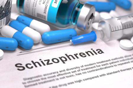 esquizofrenia: Esquizofrenia - Impreso Diagn�stico con las p�ldoras azules, las inyecciones y la jeringa. Concepto m�dico con enfoque selectivo. 3d. Foto de archivo