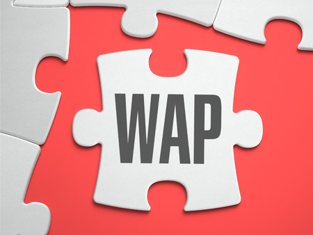 wap: WAP - Wireless Application Protocol - Text on Puzzle on the Place of Missing Pieces. Scarlett Background. Closeup. 3d Illustration. Stock Photo