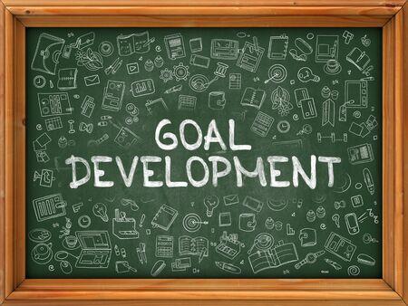 green chalkboard: Goal Development - Hand Drawn on Green Chalkboard. Goal Development with Doodle Icons Around. Stock Photo