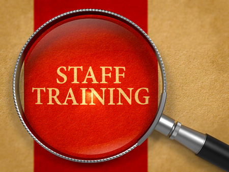 staff training: Staff Training Concept through Magnifier on Old Paper with Crimson Vertical Line Background. 3d Render.