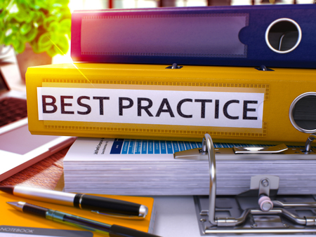 best practices: Best Practice - Yellow Ring Binder on Office Desktop with Office Supplies and Modern Laptop. Best Practice Business Concept on Blurred Background. Best Practice - Toned Illustration. 3D Render.