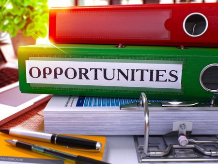 Opportunities - Green Office Folder on Background of Working Table with Stationery and Laptop. Opportunities Business Concept on Blurred Background. Opportunities Toned Image. 3D Stock Photo