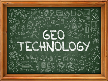 geo: Geo Technology - Handwritten Inscription by Chalk on Green Chalkboard with Doodle Icons Around. Geo Technology on Background of  Green Chalkboard with Wood Border.