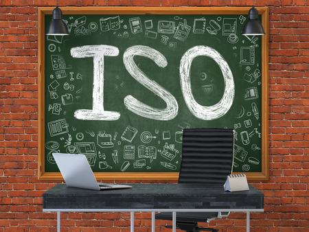 standardization: ISO -  International Organization Standardization - Hand Drawn on Green Chalkboard in Modern Office Workplace. Illustration with Doodle Design Elements. 3D. Stock Photo