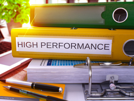 high performance: High Performance. Yellow Ring Binder with Inscription High Performance on Background of Working Table with Office Supplies and Laptop. High Performance Concept on Blurred Background. 3D Render.