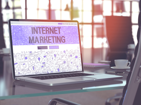 monetizing: Internet Marketing Concept. Closeup Landing Page on Laptop Screen in Doodle Design Style. On Background of Comfortable Working Place in Modern Office. Blurred, Toned Image. 3D Render.