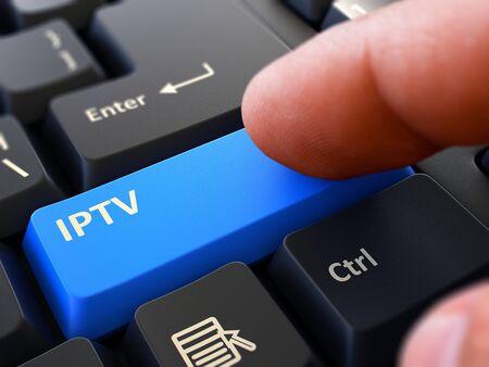 Finger Presses Blue Button  IPTV - Internet Protocol Television - on Black Keyboard Background. Closeup View. Selective Focus. 3d Render.