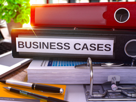 justification: Business Cases - Black Ring Binder on Office Desktop with Office Supplies and Modern Laptop. Business Cases Business Concept on Blurred Background. Business Cases - Toned Illustration. 3D Render.