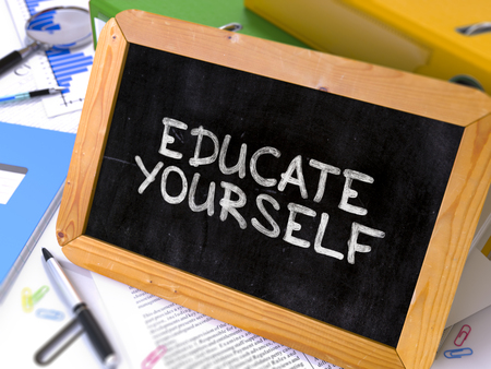 Educate Yourself Handwritten by White Chalk on a Blackboard. Composition with Small Chalkboard on Background of Working Table with Office Folders, Stationery, Reports. Blurred, Toned Image. 3d Render. Stock Photo