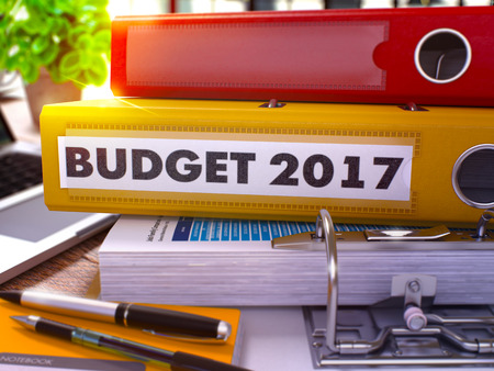 Yellow Office Folder with Inscription Budget 2017 on Office Desktop with Office Supplies and Modern Laptop. Budget 2017 Business Concept on Blurred Background. Budget 2017 - Toned Image. 3D
