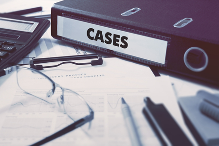 factual: Cases - Ring Binder on Office Desktop with Office Supplies. Business Concept on Blurred Background. Toned Illustration. Stock Photo