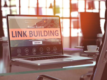 link building: Modern Workplace with Laptop showing Landing Page with Link Building Concept. Toned Image with Selective Focus. 3D Render.